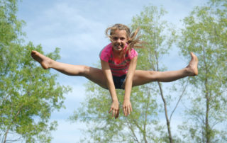girl jumping and doing the splits
