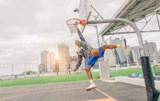 Basketball player dunking basketball with impressive vertical jump
